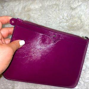 Kate spade patten leather wristlet purple